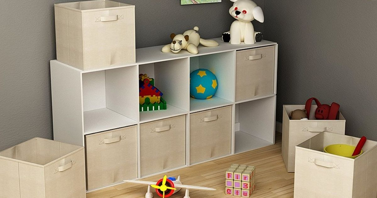 bookshelf with square cubes and fabric bins in a room with toys