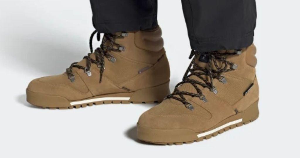 person in pants wearing Adidas Men's Terrex Snowpitch Hikers