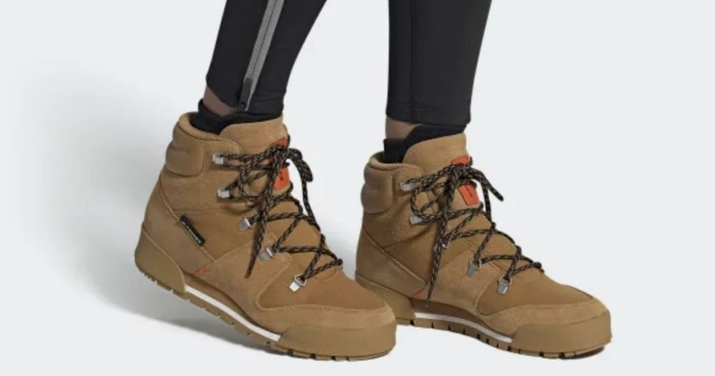 person wearing Adidas Men's Terrex Snowpitch hiking boots