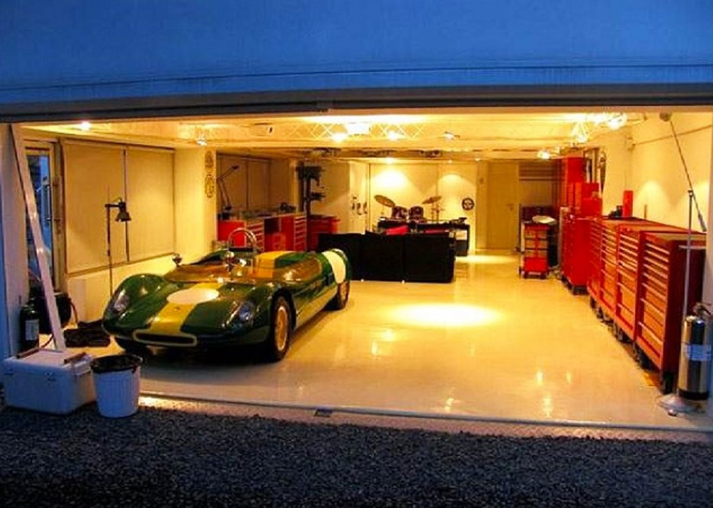 car parked in garage with warm ceiling lights shining down