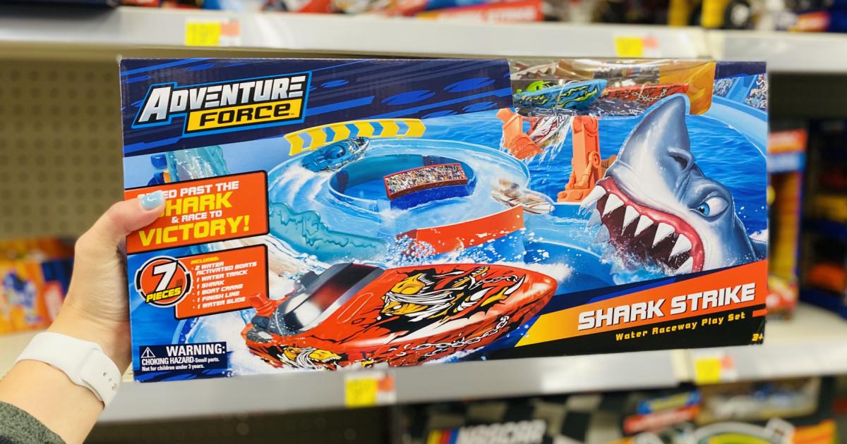 hand holding Adventure Force Shark Strike Water Raceway Play Set box