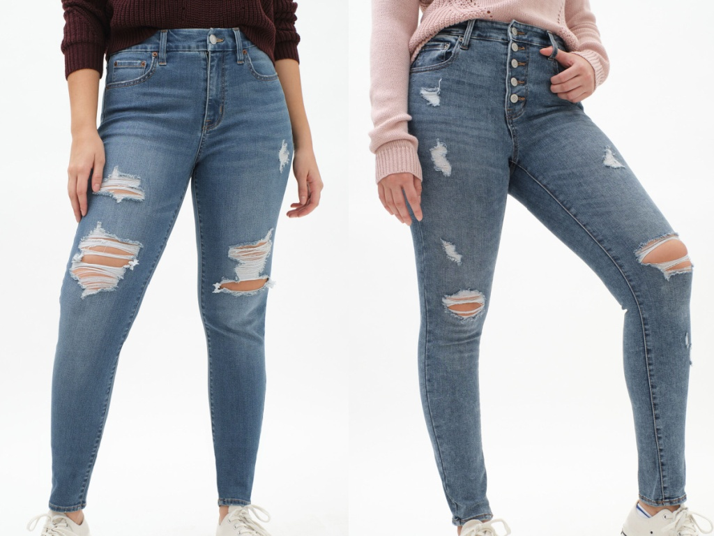 two women in high rise skinny jeans with rips and knees