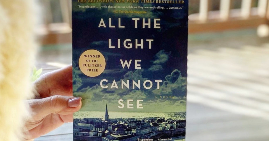 hand holding All The Light We Cannot See Book