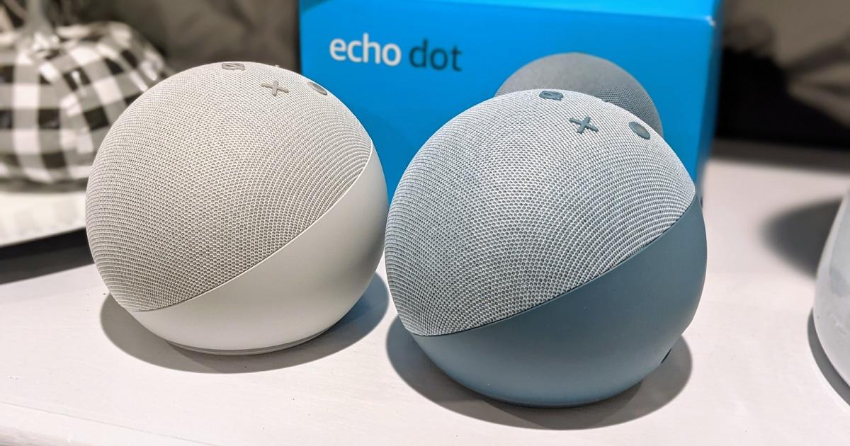 gray smart speaker and blue smart speaker on white table