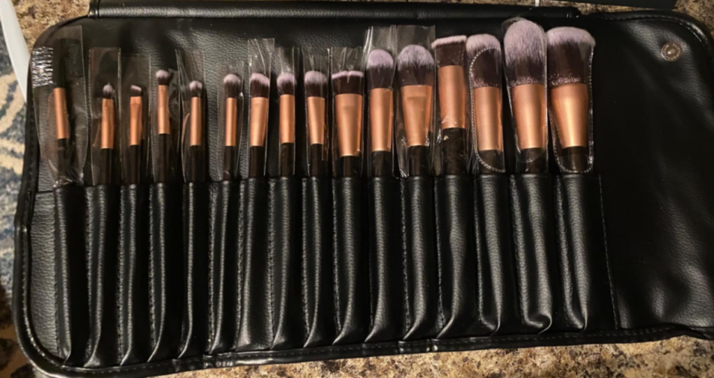 row of makeup brushes in a case