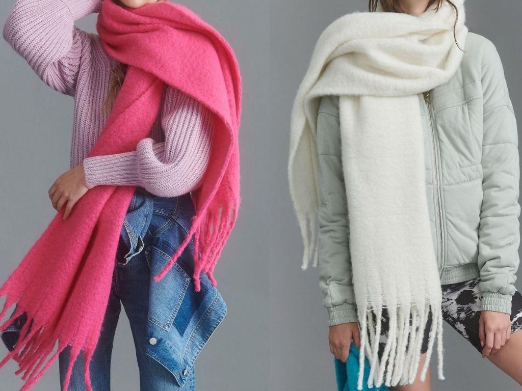 two women wearing oversize fringe wrap scarves