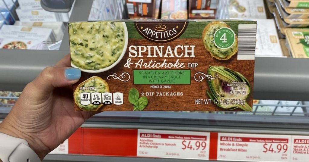 hand holding Appetitos Spinach & Artichoke Dip