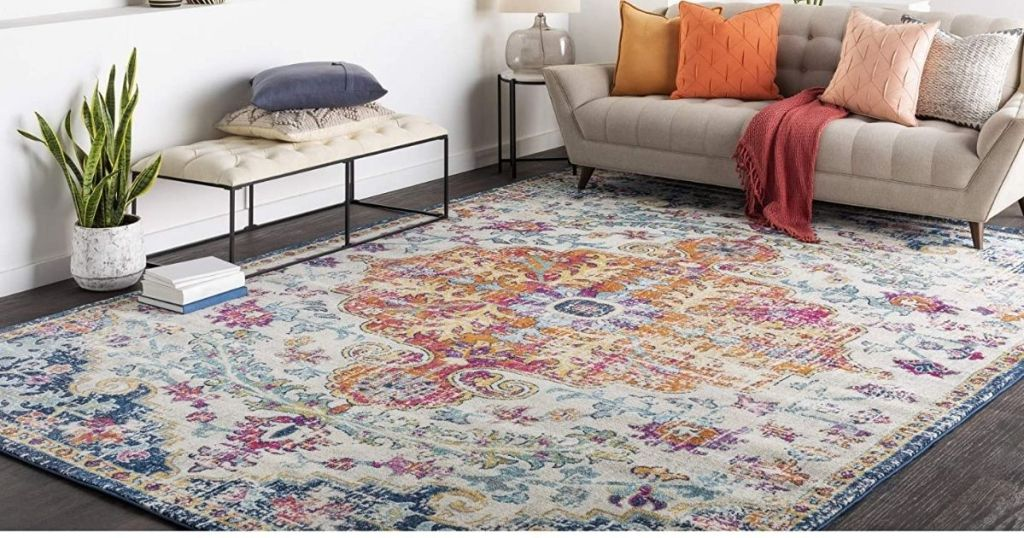 Artistic Weavers Odelia Traditional Area Rug in room with cough and decor