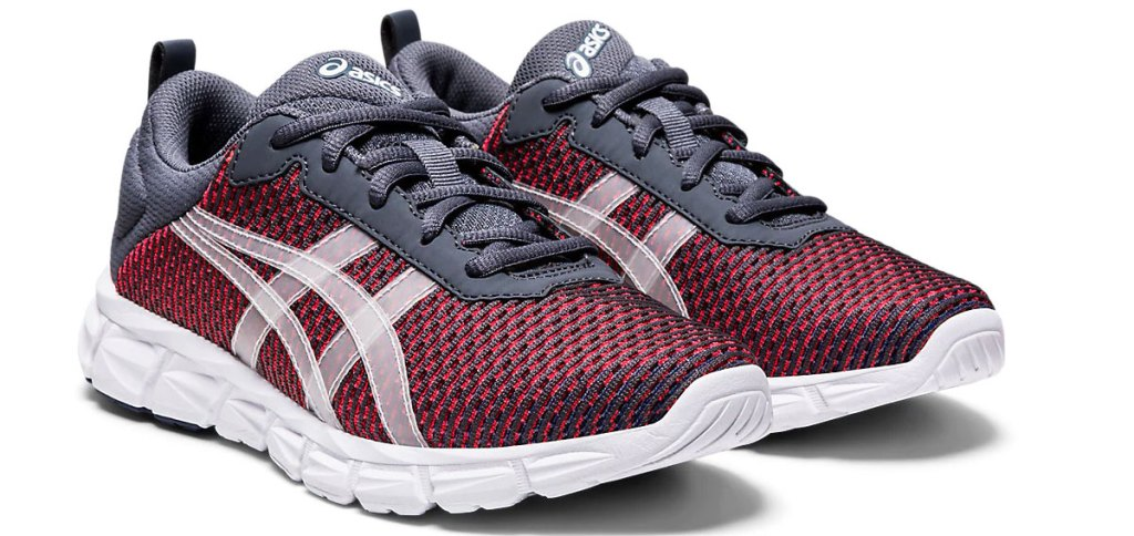 pair of grey and red mesh asics running shoes with white details