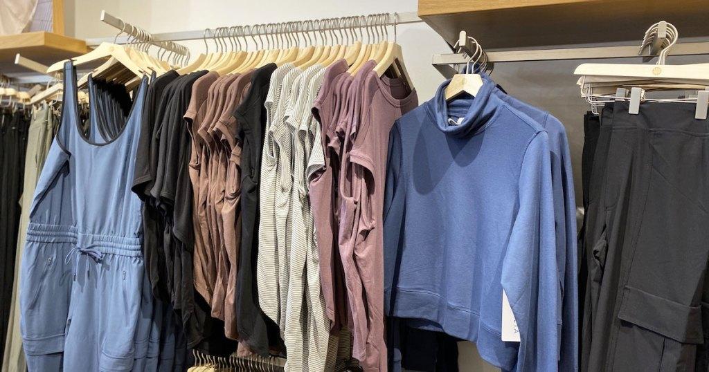 racks of athela women's apparel on display at store