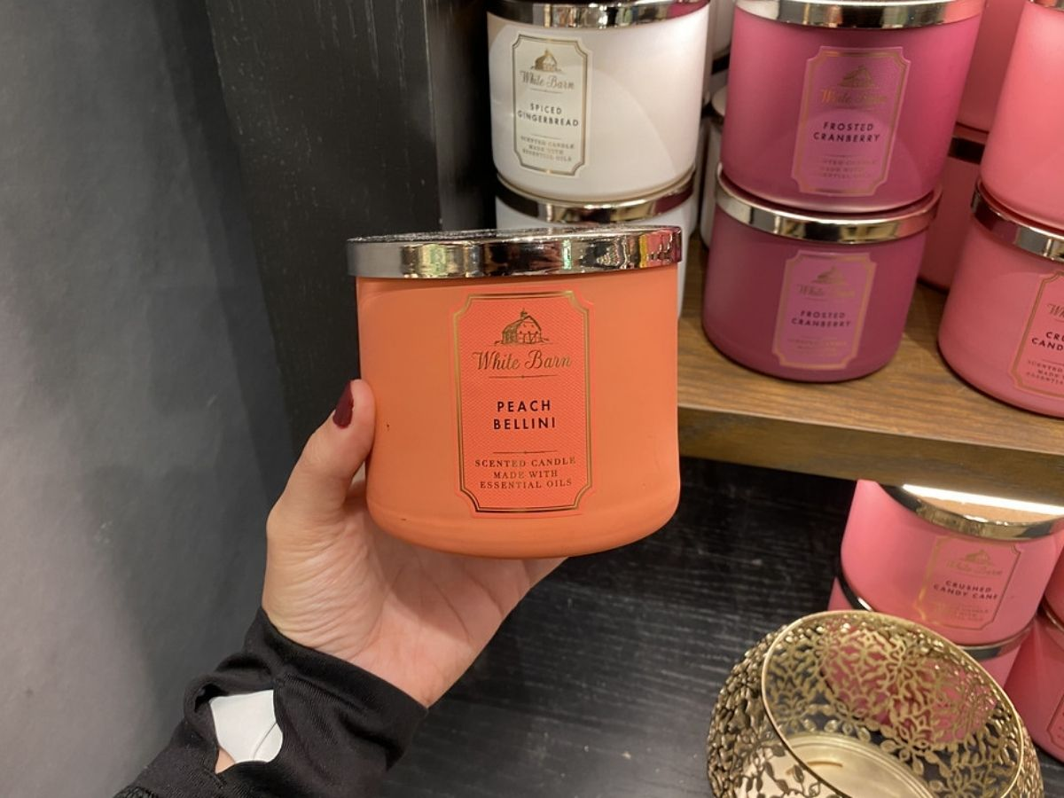 hand holding Peach Bellini candle