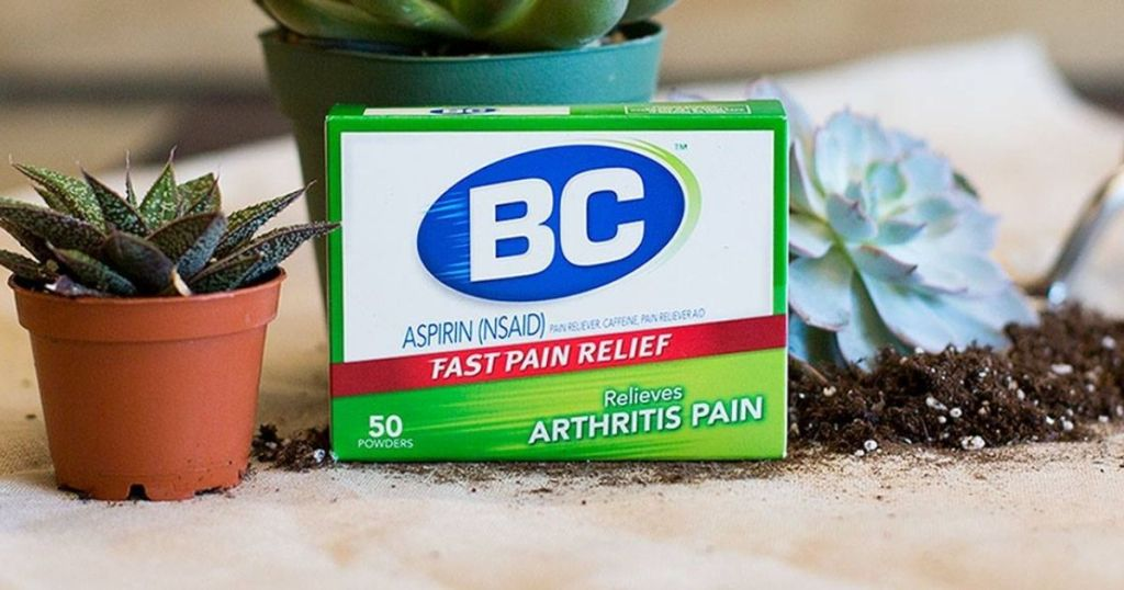 pack of BC powder next to a plant