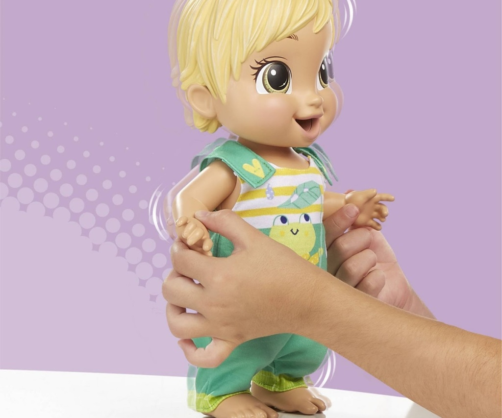 child playing with bouncing baby doll