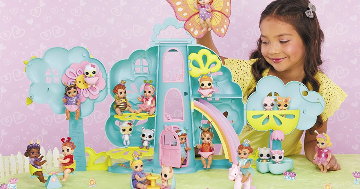 little girl playing with baby born magical treehouse playset