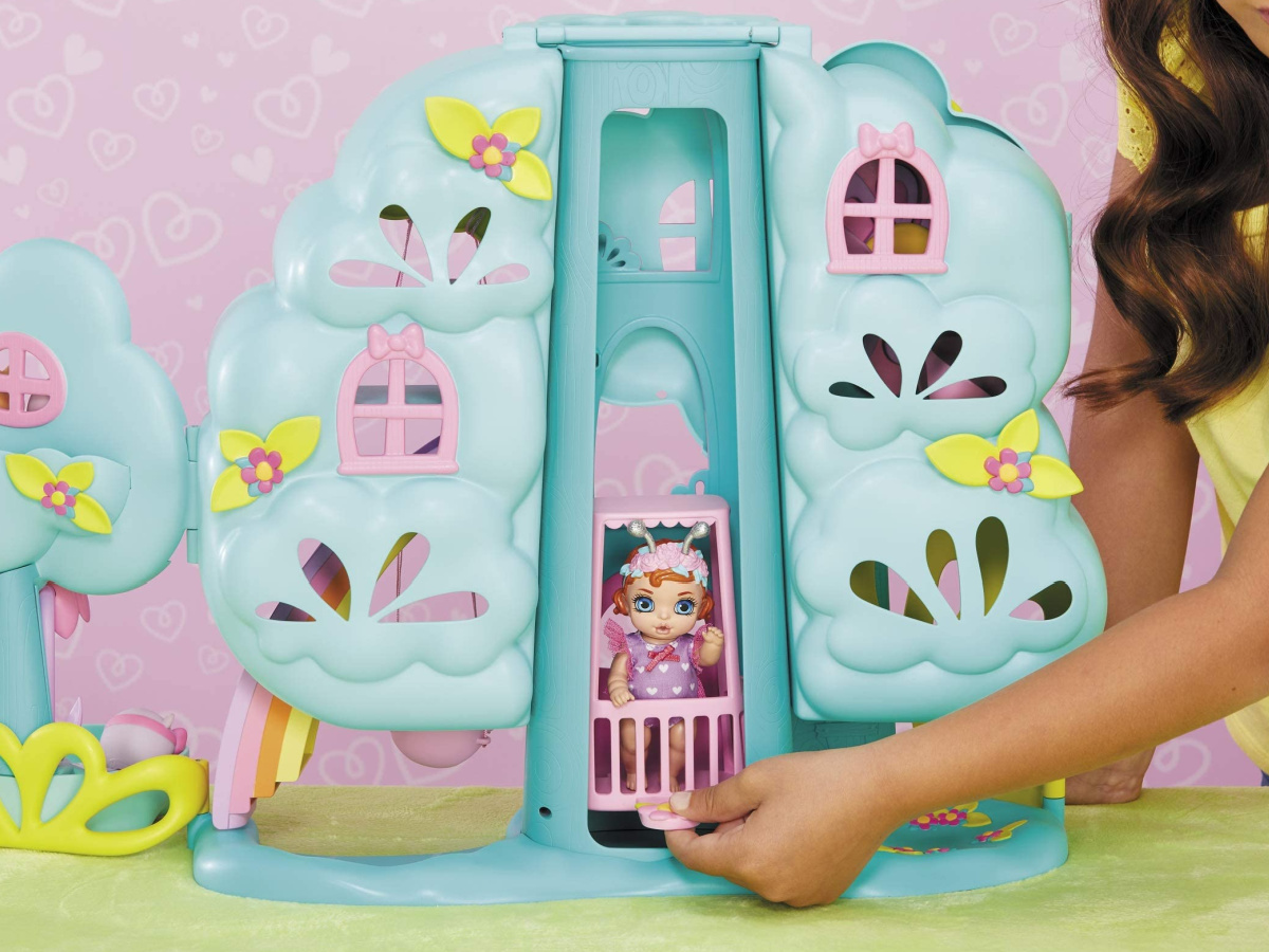 little girl wearing baby born magical treehouse playset