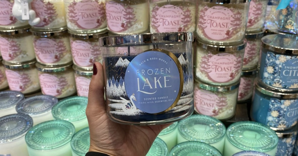 woman holding Bath & Body Works Frozen Lake candle