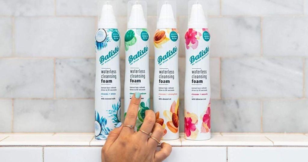 hand displaying 4 Batiste Waterless Cleansing Foam 4 Bottles