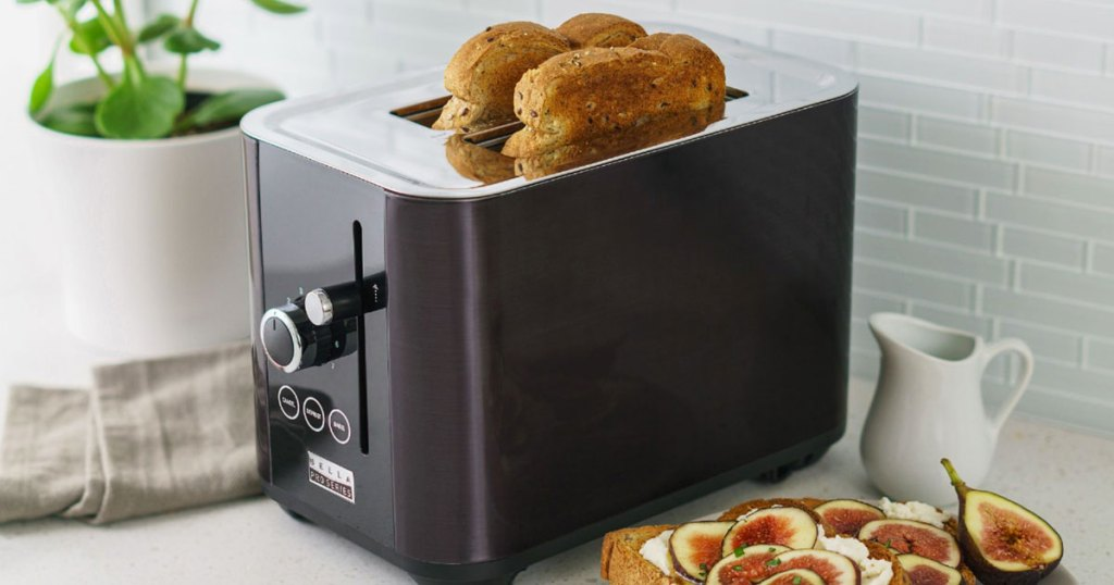 black toaster on kitchen counter with two slices of toasted bread inside