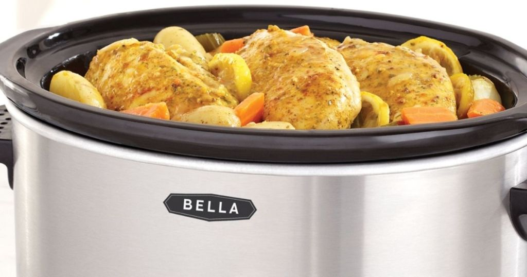slow cooker with chicken and vegetables in it