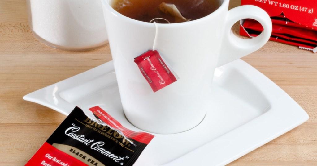 black tea bag in white mug and open bag