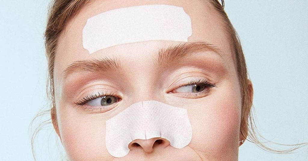 girl with Biore Nose and Face Strips applied