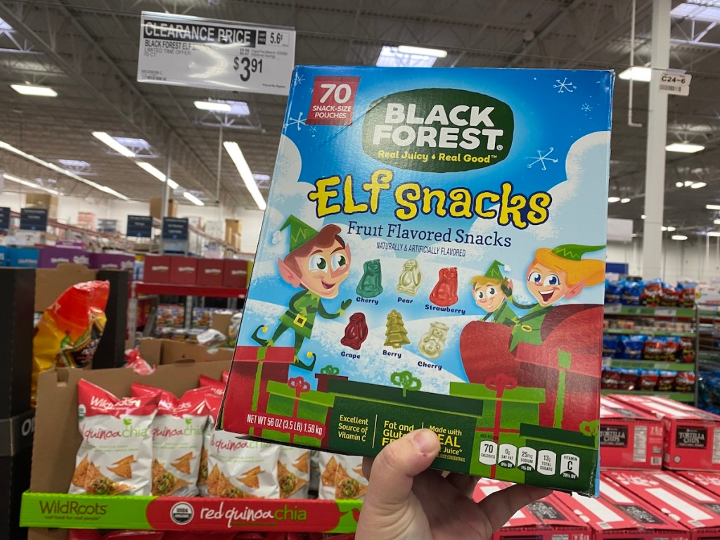 hand holding up Black Forest Elf Snacks in store