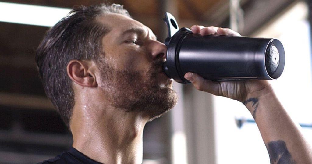 man drinking from blenderbottle