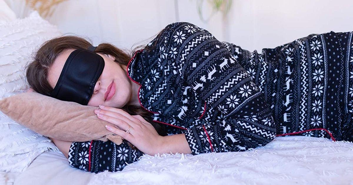 woman sleeping with a sleep mask on