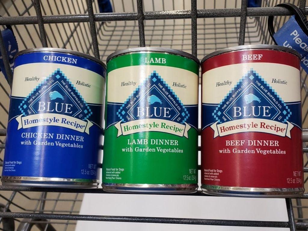 three cans of blue buffalo dog food