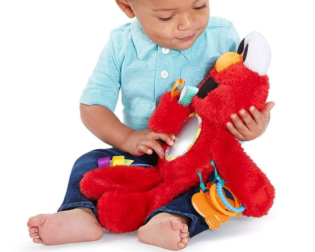 boy with Bright Starts Sesame Street Elmo Travel Buddy Take-Along Toy