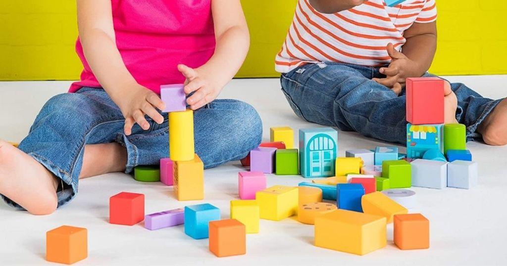 kids playing with Bright Starts Set-The-Scene Sesame Street Wooden Storytelling Blocks