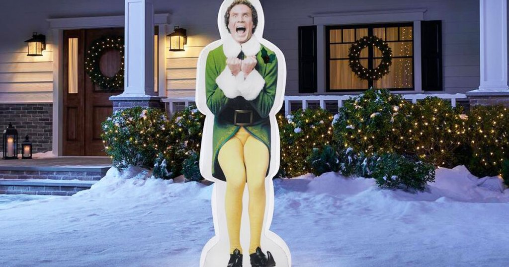 buddy the elf inflatable in a snowy front yard