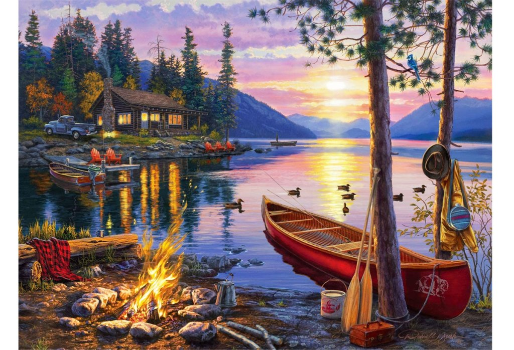 puzzle of a canoe in a lake at sunset with cabin in background