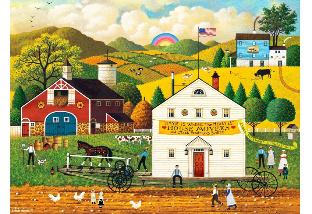 puzzle of schoolhouse and barn with farmlands and rainbow in the background