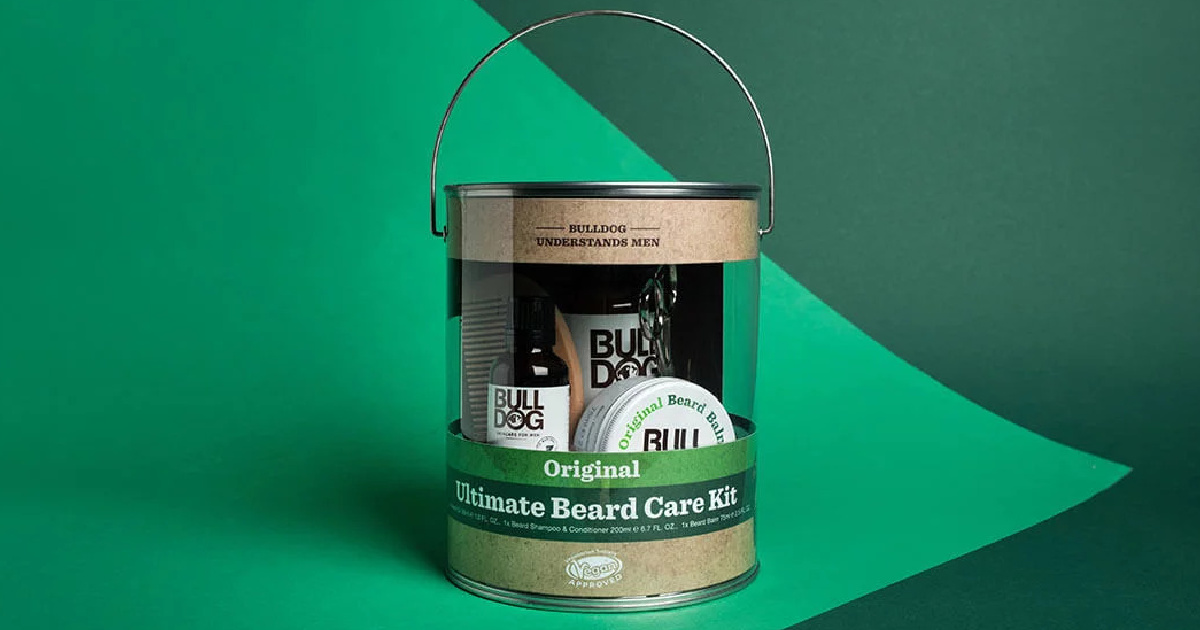 bulldog beard care kit inside paint can packaging on a green background