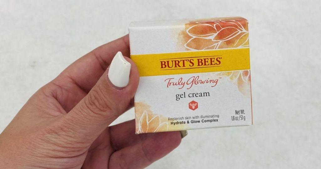 hand holding Burt's Bees Truly Glowing Gel Cream
