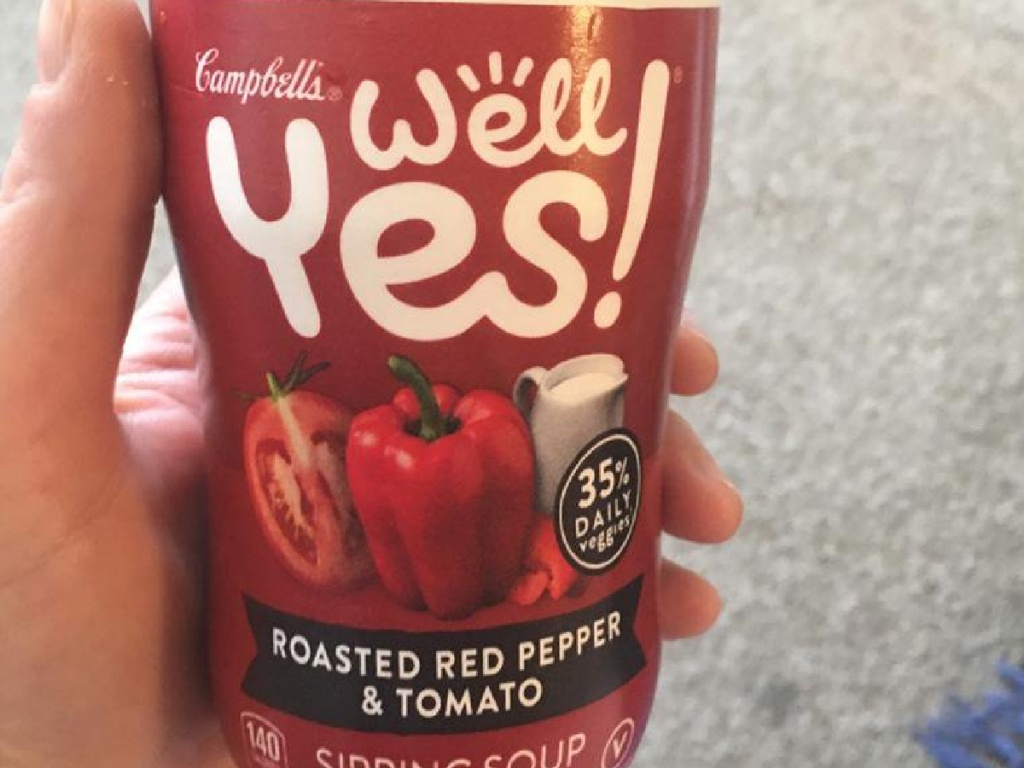 hand holding Campbell's Well Yes! Soup