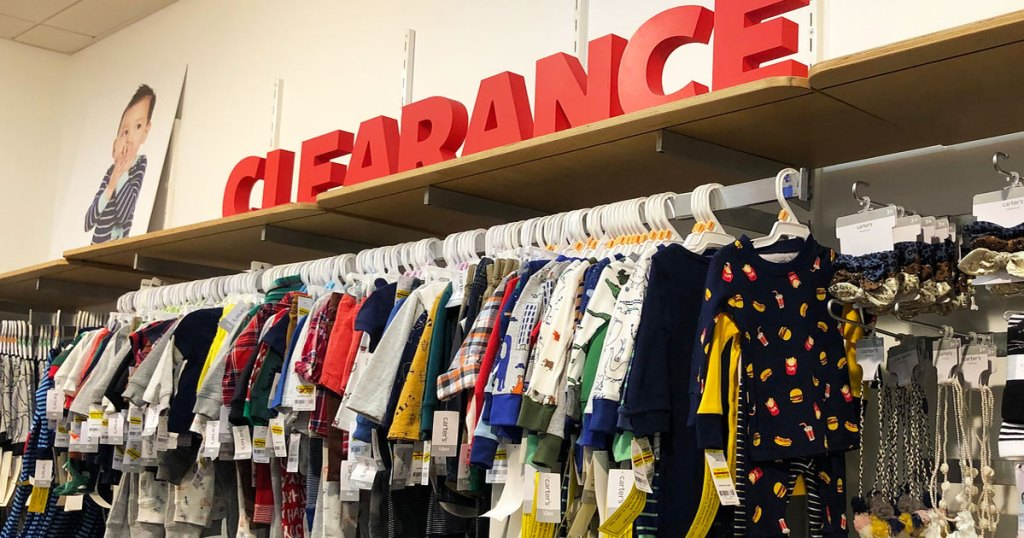 rack of carter's clothing with large red letter that spell out clearance