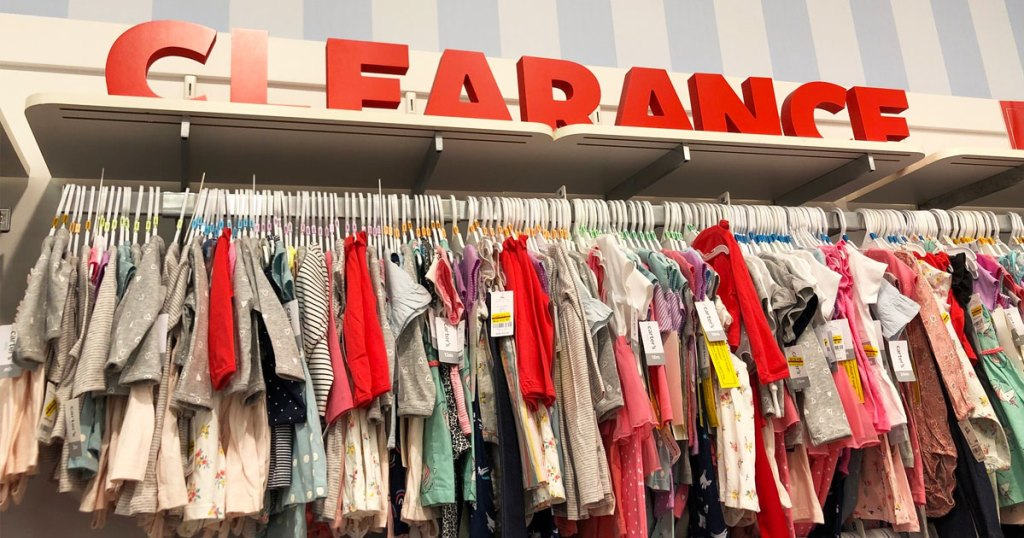 display rack of carter's clothes with large red letters above it that says clearance