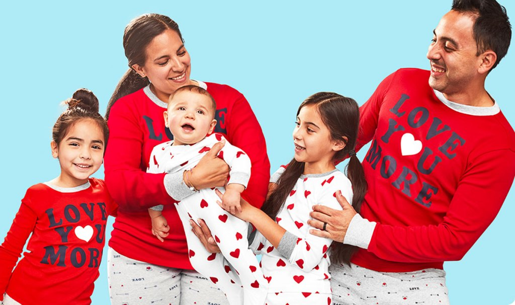 family in matching valentine's day red and white pajamas
