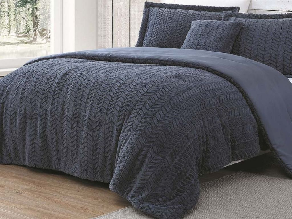cozy comforter set on bed with shams