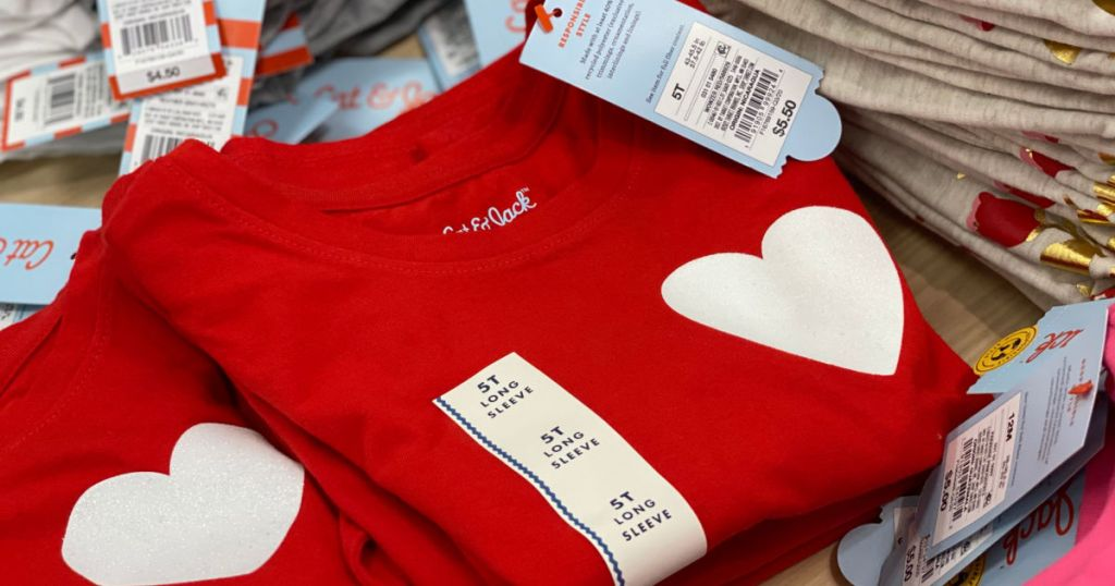 red kid's shirt with white heart