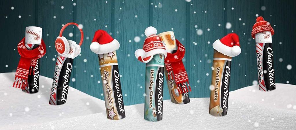 row of Chapsticks with Santa hats on