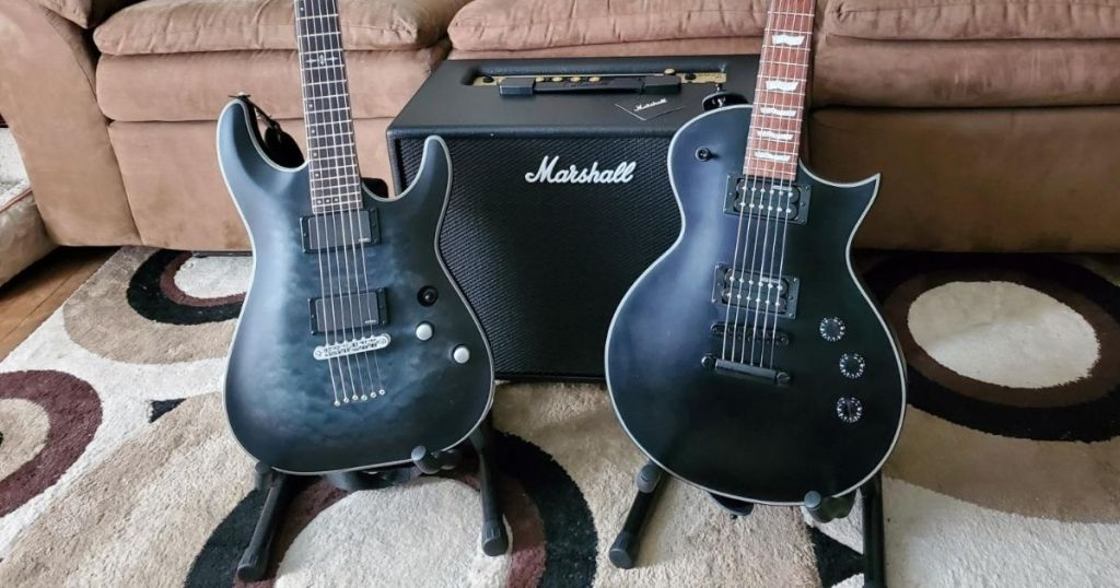 two guitars on stands