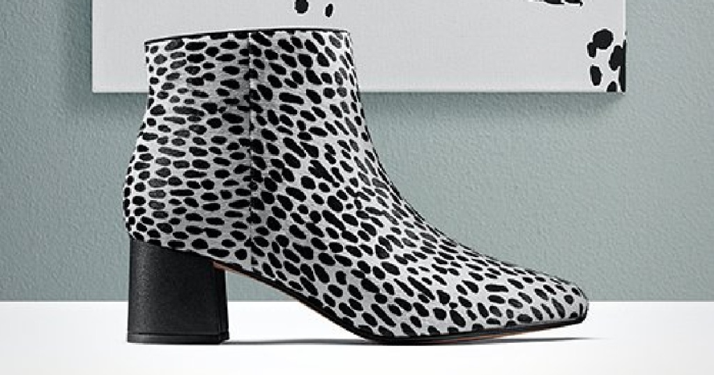 black and silver pair of clark booties