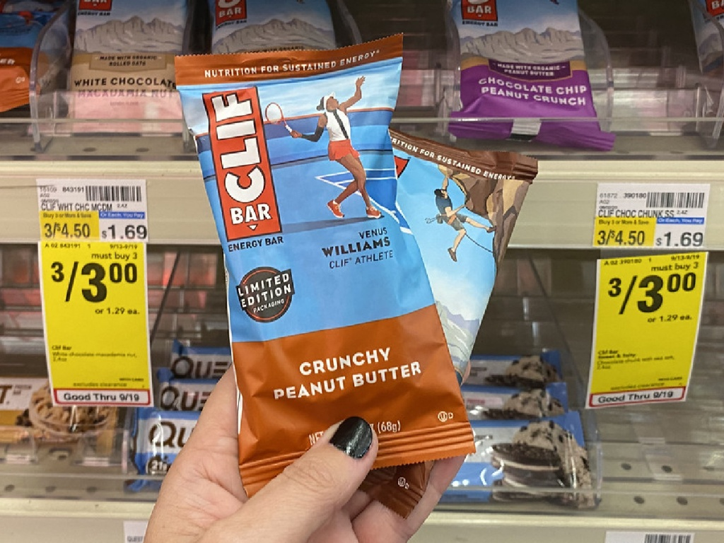 hand holding single crunchy peanut butter energy bar in store