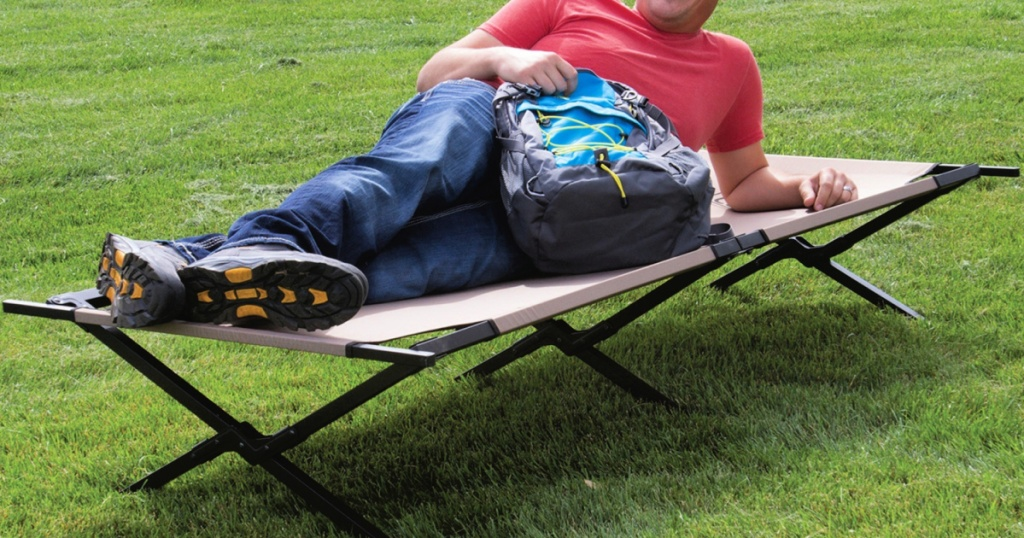 man laying on a cot