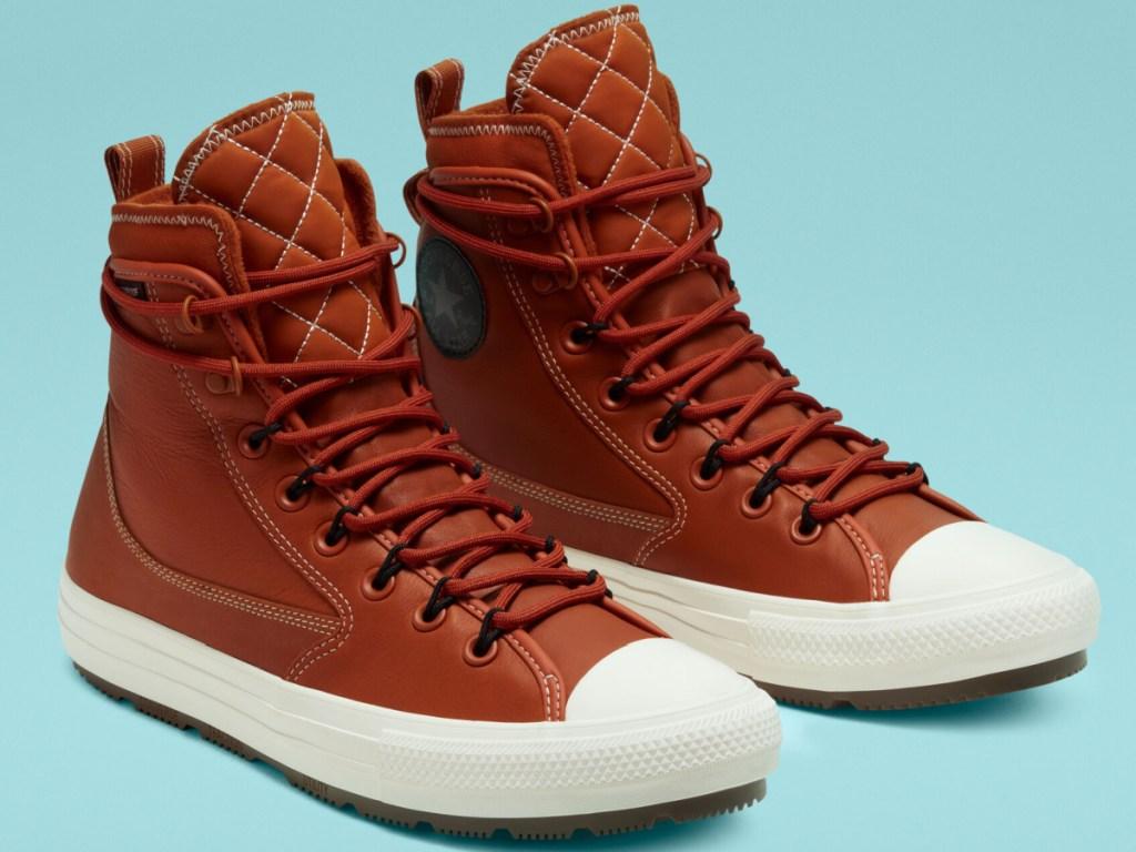 orange brown high top converse boots