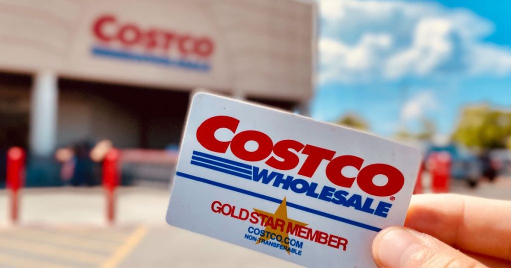 holding Costco card outside warehouse