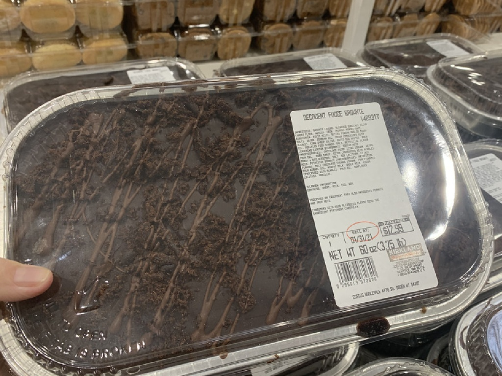 hand holding large fudge brownie container in store